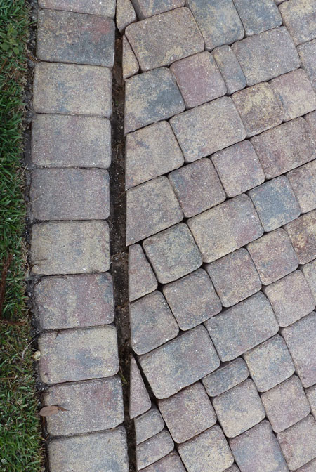 example of paver drifiting caused by vehicles turning on curved paver driveways