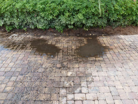 water ponding on paver driveway